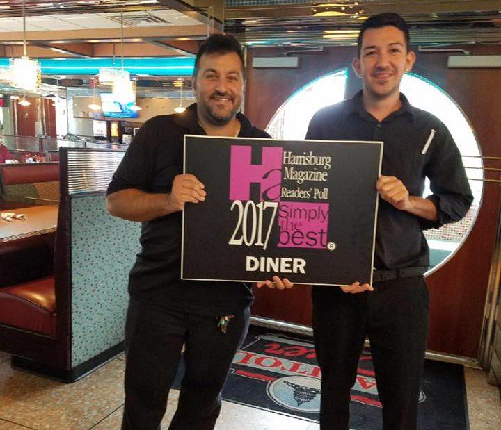 two men holding a harrisburg magazine best diner award